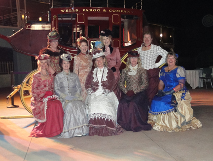 the group in front of the wells fargo stagecoach